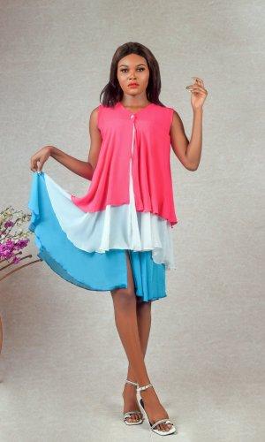 model wearing tri-coloured buttoned chiffon ruffle dress designed by Ria Kosher