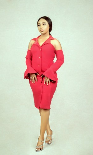 lady wearing a red bell sleeves hourglass suit dress by Ria Kosher