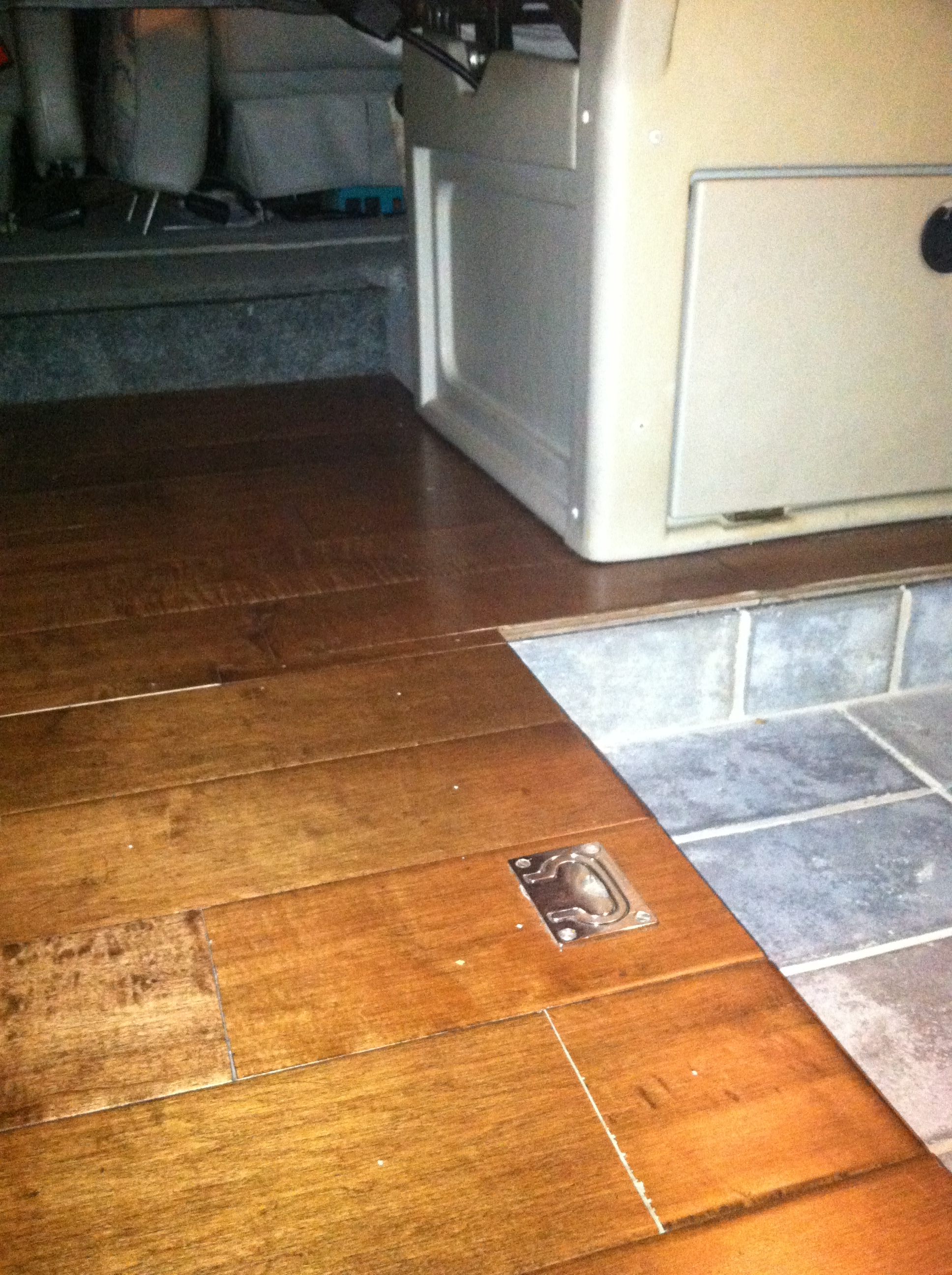Rialta Wood Floor Modification with Tile Entryway  Were