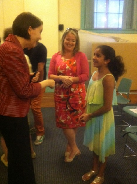State Education Commissioner Deborah Gist speaks with children and their families