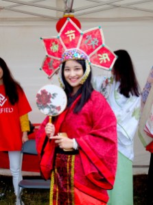 Volunteer in traditional clothing