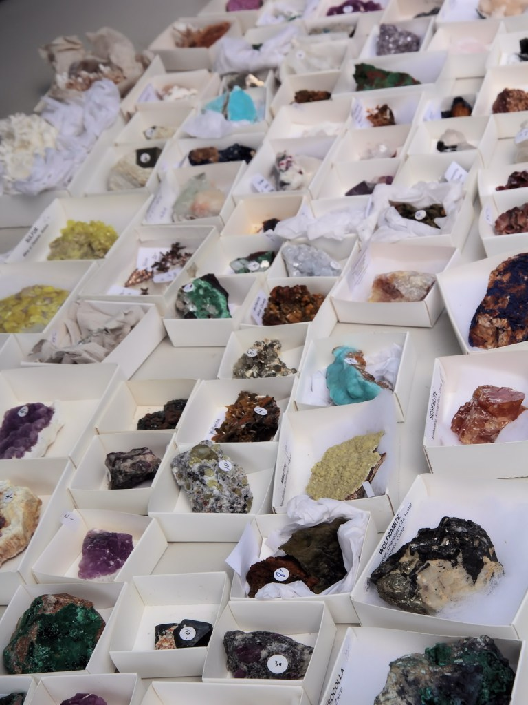 Precious gems and minerals on display in vendor's booth.
