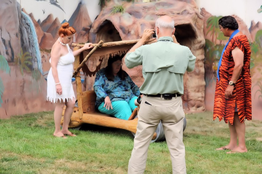 Julian Gray photographs Fred and Wilma Flintstone and Summer Fest guest in Flintmobile.