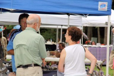 Julian Gray and Barb Epstein visit a vendor booth and shop.