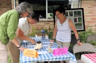 Barb Epstein works with bidders at the silent auction booth.