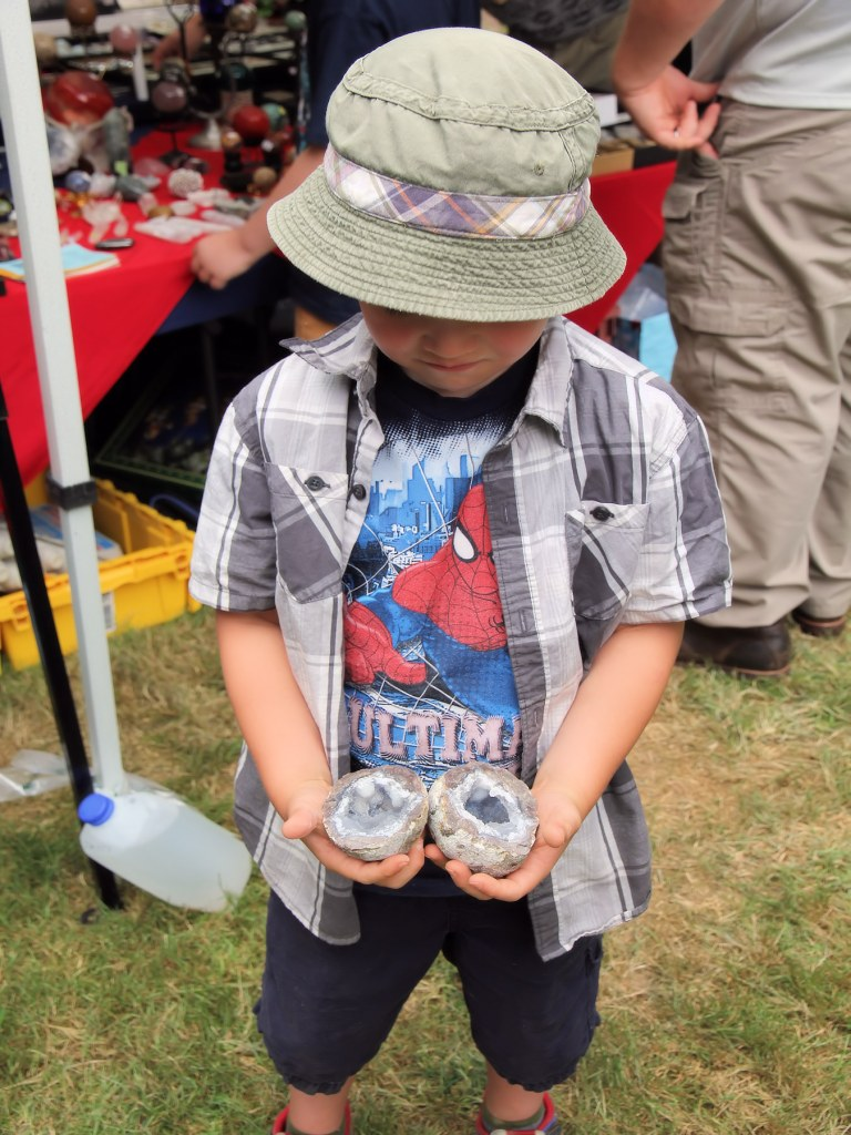 Child holds freshly cut geodes in hands.