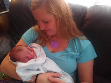 Aunt Liz holds baby Rylan for the first time