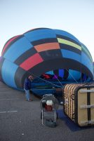 Balloons are first filled with air from a fan