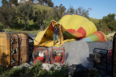 The process to fill a hot air balloon takes at least four people