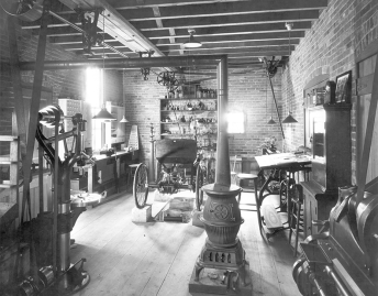 He built his first successful automobile in the woodshed behind his house on Bagley Avenue in Detroit. Here's how he reconstructed his workshop for his great museum. What he called the Quadricycle is at the rear, up on blocks.