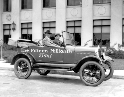Henry and Edsel take a final ride in 1927, just before the end of the Model T's two-decade run.