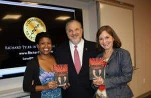 worlds-top-sales-trainer-and-management-consultant-ceo-richard-tyler-with-two-fans-and-their-signed-copies-richard-tylers-best-selling-book-boom