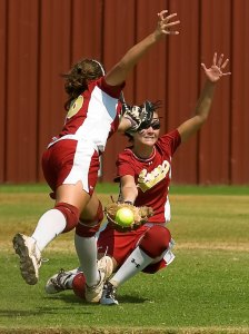A Byng Pirates infielder collides with a Byng outfielder during a matchup against the Ada Lady Cougars in their annual Back to School Classic softball tournament co-hosted by Byng and Konawa. This image was made with my 80-200mm f/2.8 AF-S Nikkor on one of my D2Hs.