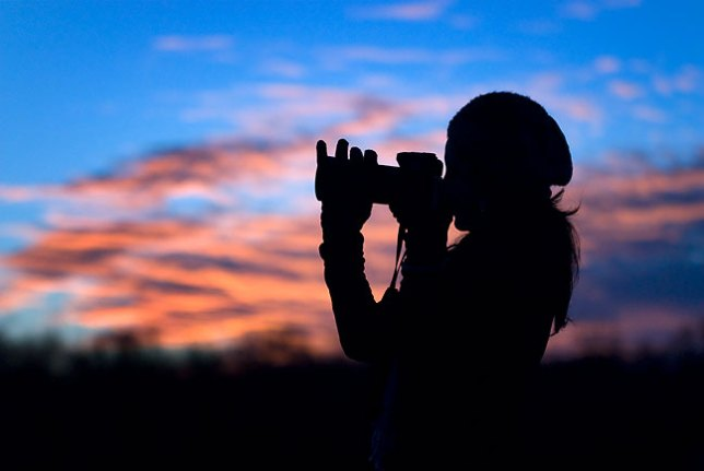 Using a photographer as a compositional element against a beautiful evening sky.