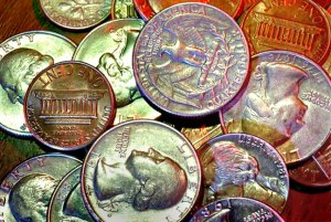I made this image of coins on my desk in 1984. I turned off all the room lights, opened the shutter, and flashed the coins four times, each with a different colored gel on the flash. I got the results back from the processor a week later.