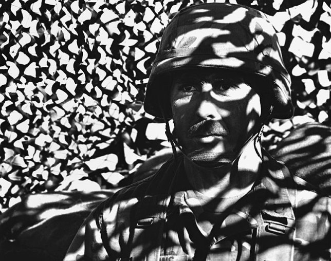 An army reserve soldier demonstrates the value of camouflage, 1990