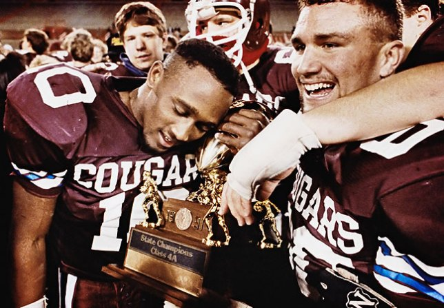 The Ada Cougars celebrate their 1991 state championship, one of five football championships for Ada I have covered.