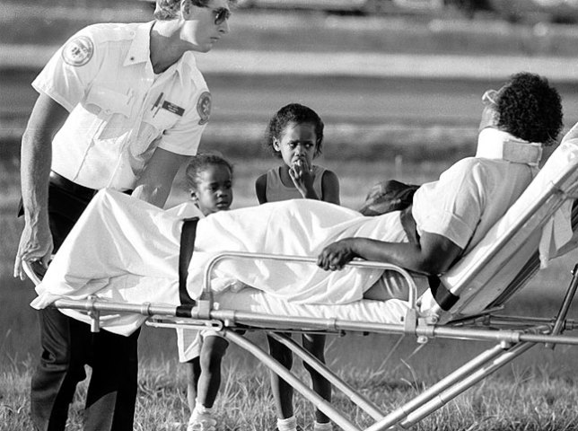 Two children watch as their grandmother is taken to a hospital after a traffic collision, 1986