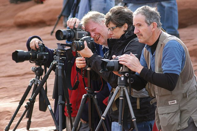 Photographers at Arches National Park in Utah in April 2011: their postures and facial expressions are ruggedly serious and their cameras are all obediently trained on the iconic Delicate Arch. The light at the time, however, was the dullest and least inspirational I have ever seen at this location.