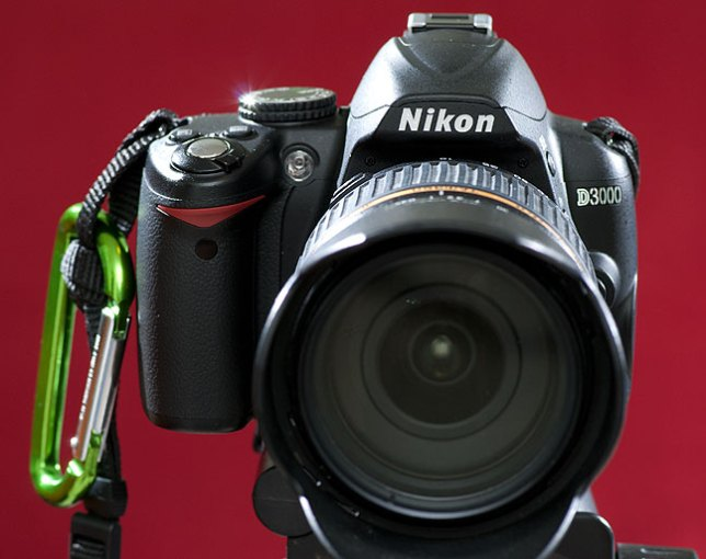 The Nikon D3000 is about four years old, but if you picked one up on the used market,  I would recommend it.