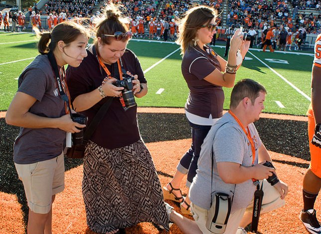 Photographer friends of mine photograph the coin toss at a recent college football game in Ada using modern Canon digital SLR cameras.