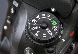 I discussed this in a pervious entry, and I am very glad to see it: a lock button in the center of the exposure mode dial to prevent accidental changes. Bravo, Nikon.