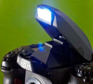 Most digital cameras have a pop-up flash, like this one atop the viewfinder of a digital SLR. An important exception is that professional cameras don't have this feature.