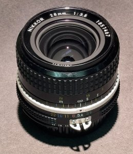 """I bought this Nikkor 28mm f/3.5 used in the mid 1990s. It is an """"AI"""" lens, which dates it as pre-1981 or so. I think I paid $75 for it. It was lightweight and amazingly sharp."""
