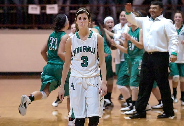 Stonewall roundballer Lauryn Humphers walks toward her team's bench after the Lady Longhorns lost to Rattan in area tournament play at the Cougar Activity Center March 1, 2015.