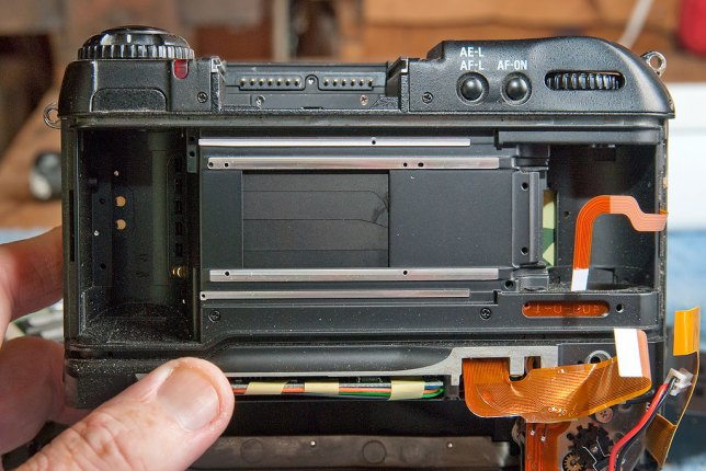 "The ""Frankencamera"" aspect of the DCS760 is abundantly clear in this view showing empty space where a film cassette, on the left, and the space for film to wind, on the right, are empty."