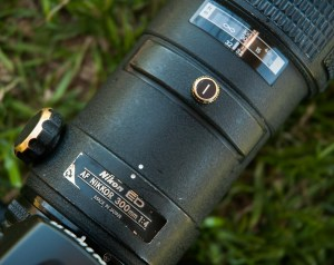 I photographed the workhorse AF 300mm f/4 at a baseball game last spring, showing much of the paint on the metal surfaces showing brass from years of service. This lens died last week.