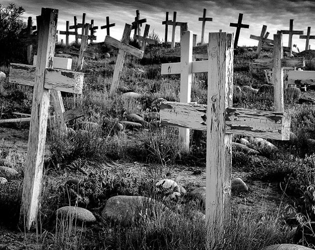 I photographed this mission graveyard on the Bisti Highway south of Farmington, New Mexico on a bitterly cold morning in November 2003.