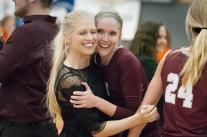A happy moment that was over in about three seconds: Menee Thomsen congratulates Kenzie Dean after the Lady Cougars won the area championship game.