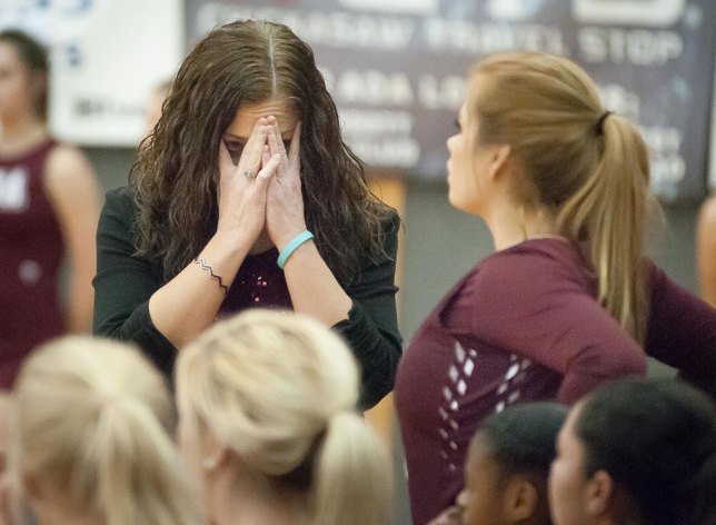 Part of being read to make pictures is being ready to shoot the hard ones along with the easy ones, like this stressed-out moment for coach Christy Jennings as her team struggles to come from behind in their area championship game.