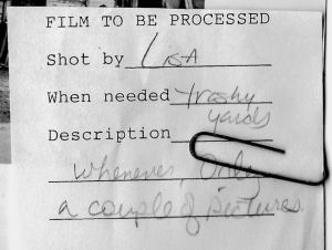 When a reporter shot some film, he or she would attach this little slip of paper to it, which I would paperclip to the print.