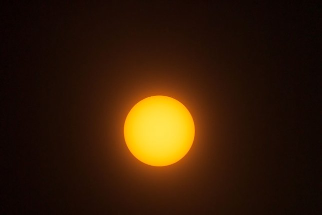 "This is a test image of the sun I made today under hazy skies, shot with my 400mm f/3.5 Nikkor, my 1.4x Nikon teleconverter, and a small piece of ""eclipse glasses"" film on the 39mm drop-in filter in the lens."