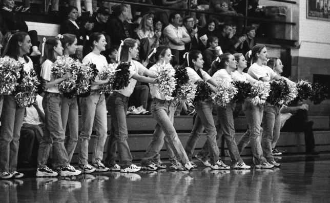 Ada High School Couganns greet their team in the Ada Junior High gym in 1998, near the end of the film era. It's a usable Kodak P3200 image, but compared to digital, it is grainy, contrasty, dusty, and expensive.