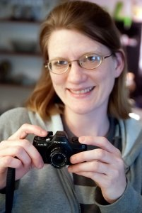 Jamie holds her Pentax Auto 110 five years ago. She lent it to me this week to photograph.