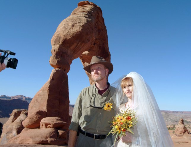Abby and I beam as we exchange vows at Utah's iconic Delicate Arch, photographed with the Fuji S2 Pro.