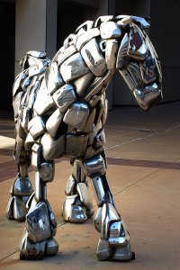 A horse sculpture made from chrome car bumpers stands on the street in downtown Wichita, Kansas in November 2003. I photographed it with the D100.