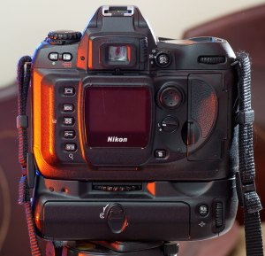 The D100's lens mount is the Nikon F-mount, and it will autofocus earlier Nikkor AF lenses.
