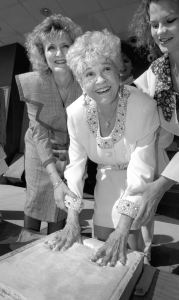 Music legend Mae Boren Axton presses her handprints into cement at the McSwain Theater in the 1990s, not long before her death. I am honored to record this kind of history for our community.