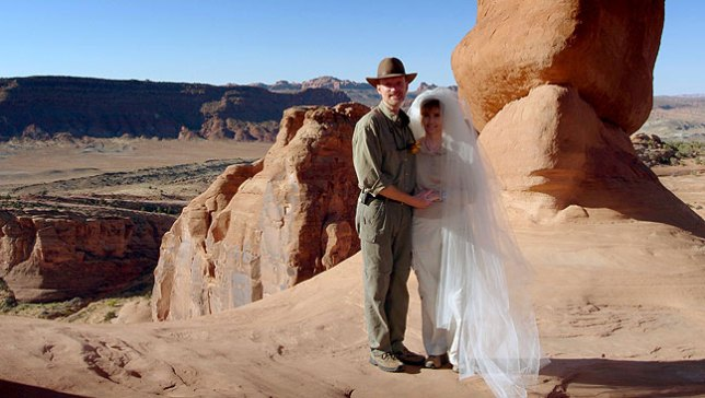 Abby and I pose under Delicate Arch, in Utah's majestic Arches National Park, just minutes after getting married there.
