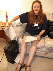 "Nicole using the shredder, wearing Mom's ""Ask me about my granddog"" shirt."