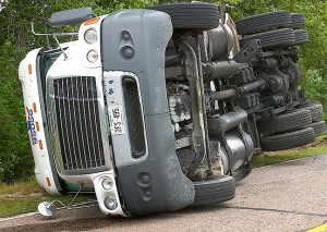 File photo of an overturned tractor-trailer rig