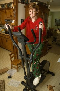 "Abby on her new elliptical trainer, looking amazingly cute in her ""Ho Ho Ho"" pajamas"