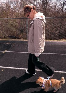 Abby walks Sierra on the Byng High School track this afternoon