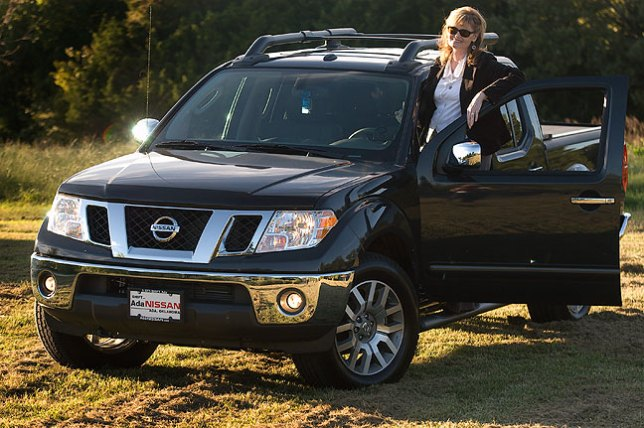 Abby poses with her Frontier pick-up; it took our dealer a couple of weeks to find just the right one.