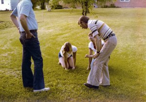 My dad, my cousin Lori, my aunt Carol and uncle Wes in the Barron's back yard, circa 1976.