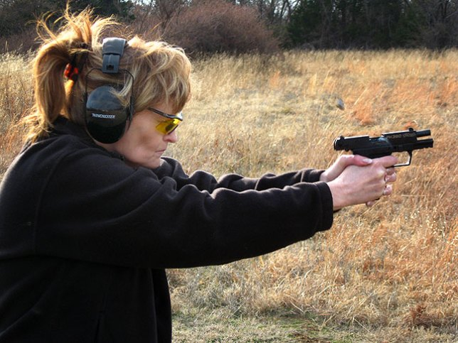 Abby shoots her new Walther PK380 down at the pond yesterday. I think it's neat that you can see the round ejecting and smoke coming from the breech.